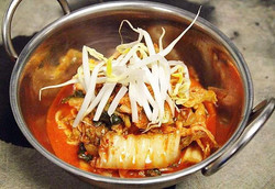 Kimchi - good for your stomach and your soul!  Fermented Korean cabage a perfect side dish to any me