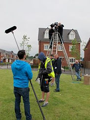 Television crew in front of house
