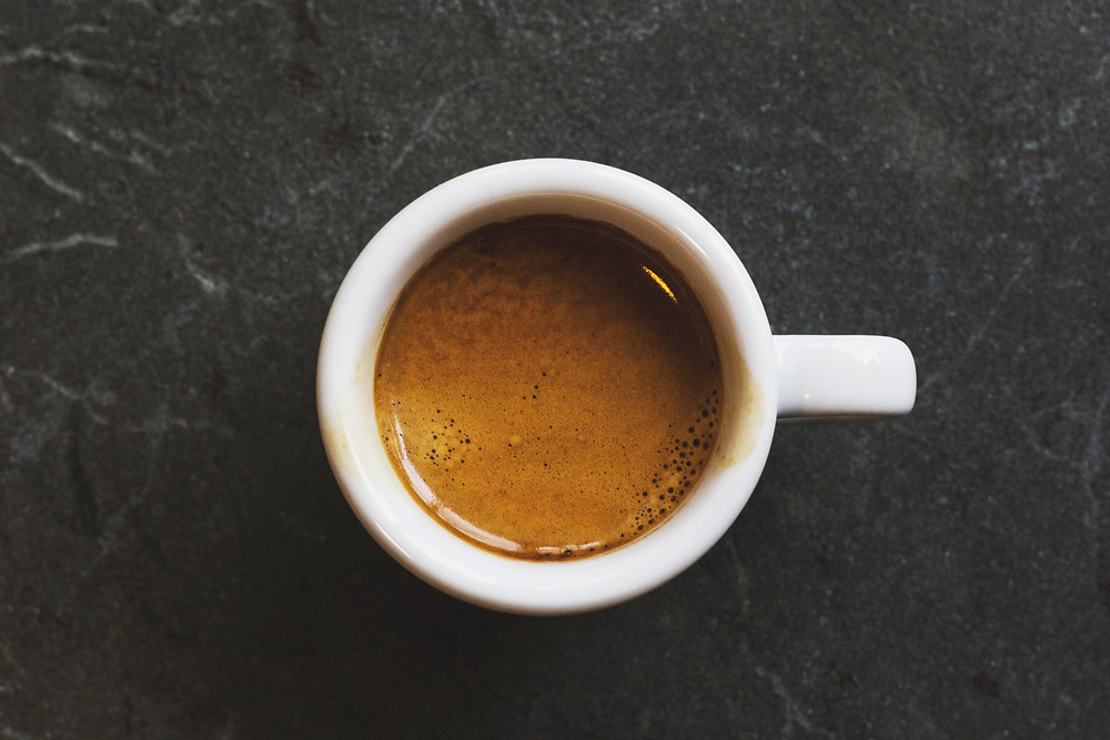 espresso cup with caffeine helping boost energy for workouts