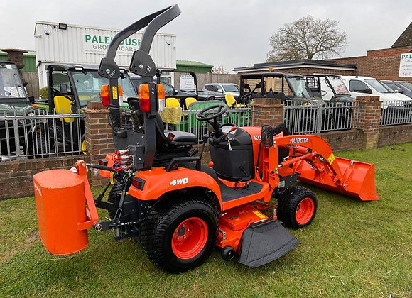 Kubota BX261 compact tractor with loader and mid deck