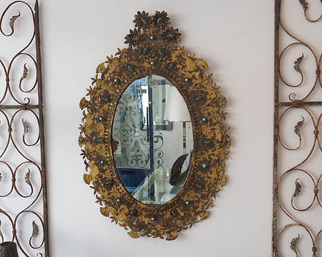 Lovely distressed gilded tole oval mirror