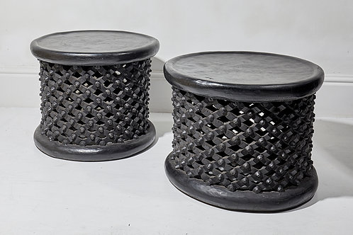 A pair of Zimbabwian black hardwood tables carved from the Mukwa tree