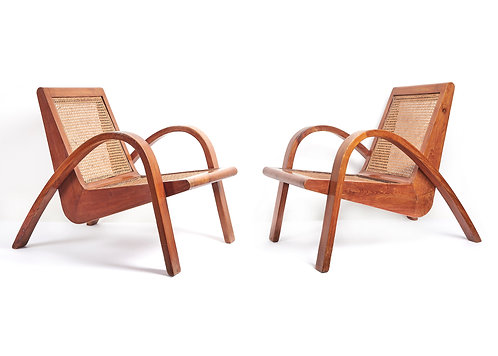Rare pair of cane seated teak armchairs attributed to Pierre Jeanneret