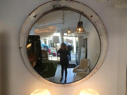 Convex mirror in white enamelled metal frame