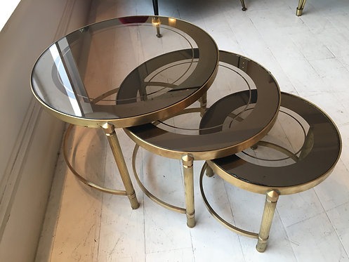Nest of three circular tables