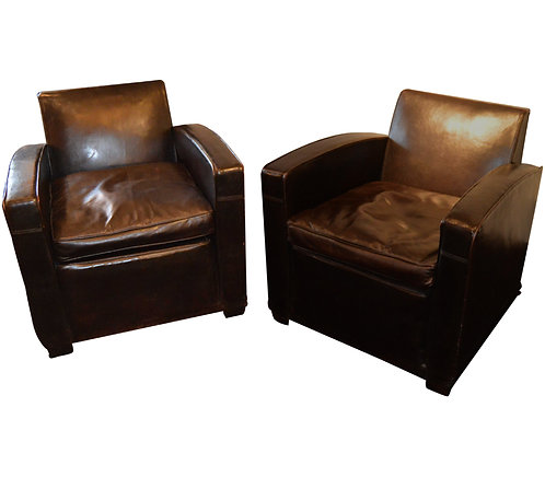 Pair of leather covered armchairs by Jacques Adnet