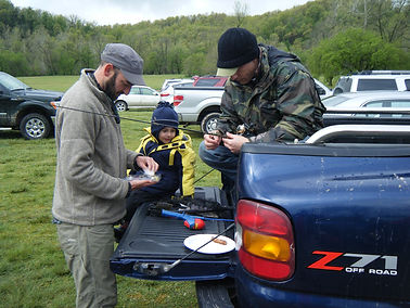 TroutBusters setting up poles