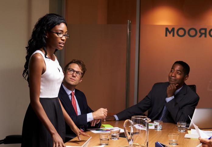 Black%20businesswoman%20stands%20address