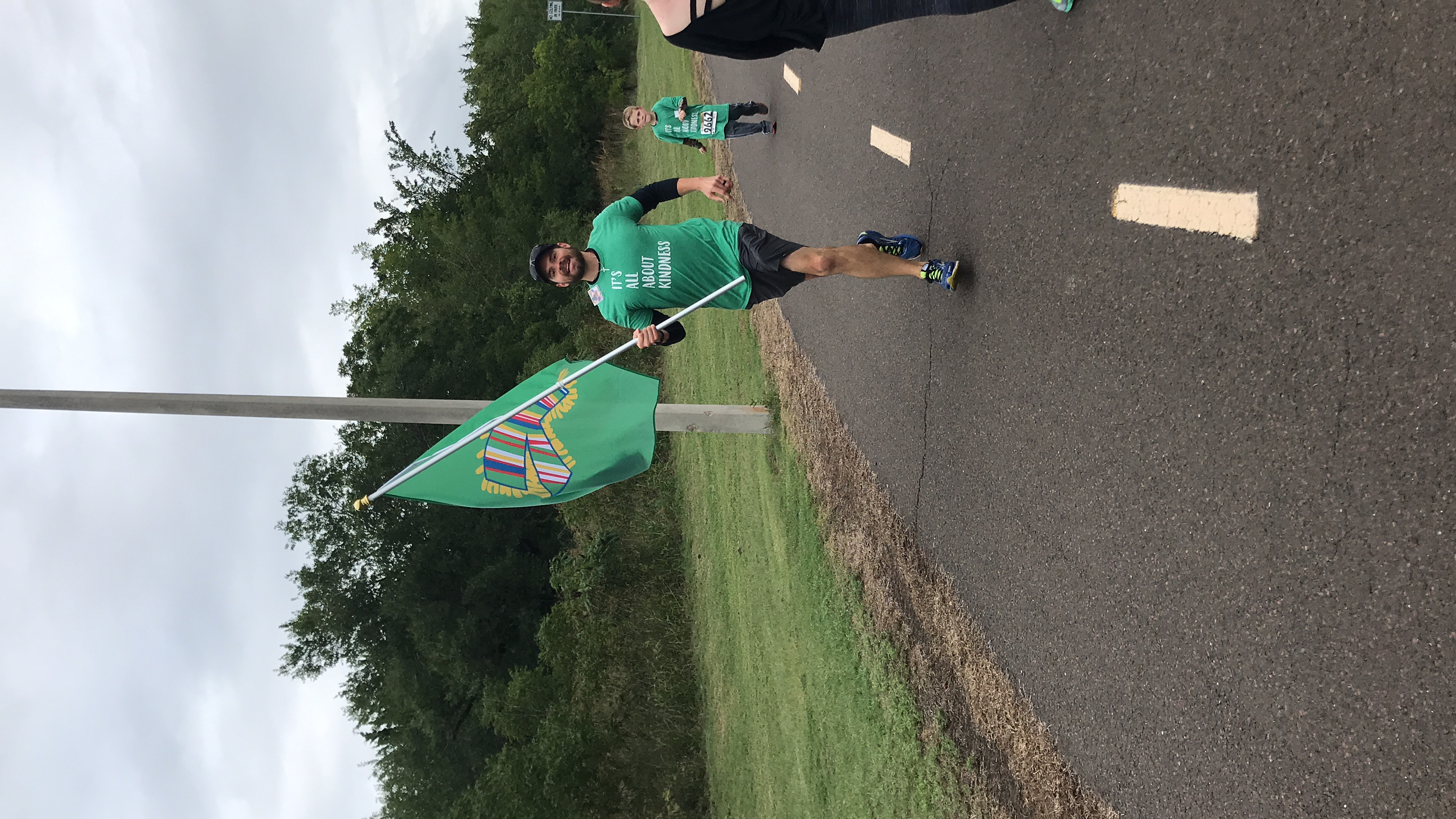 Tim running with the flag
