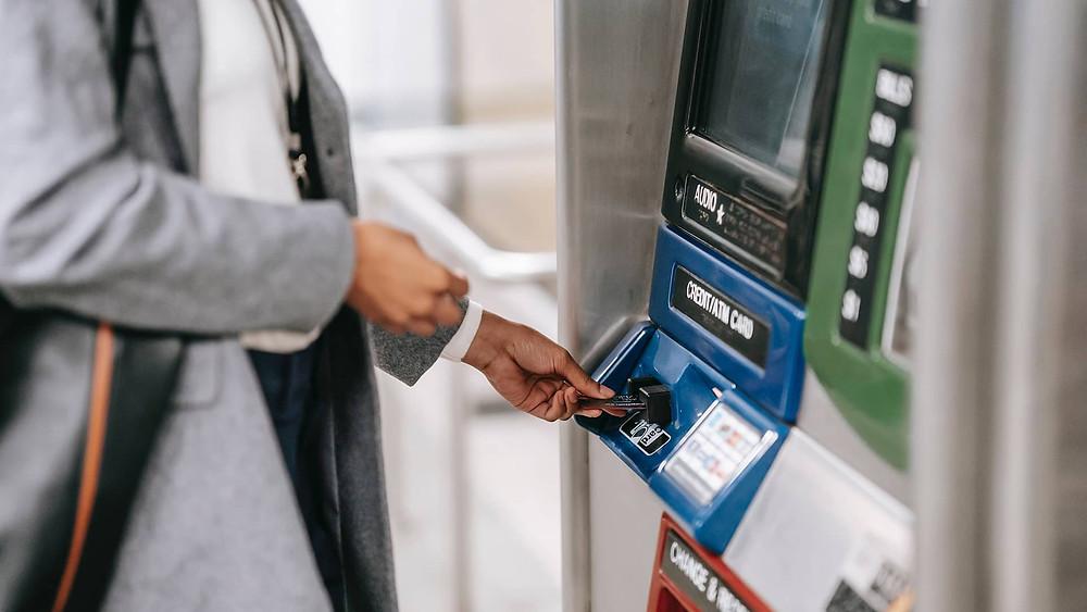 Customer using ATM machine