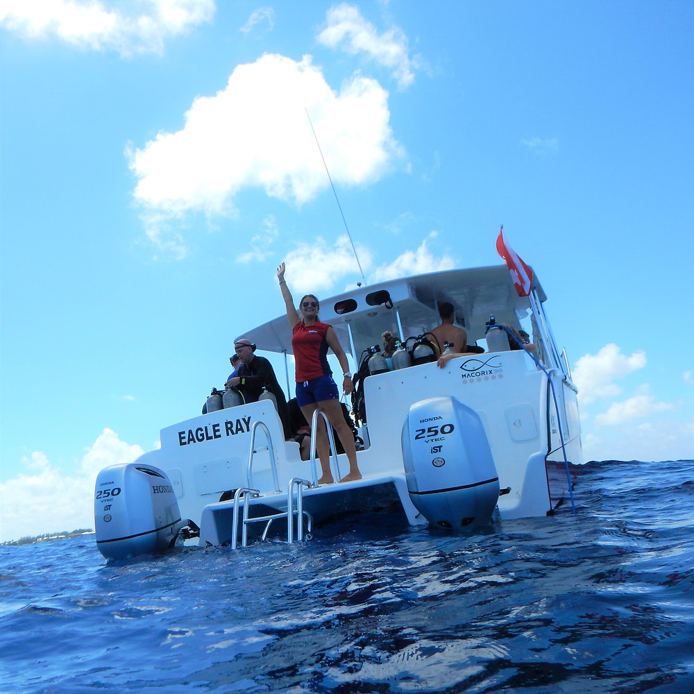 Sunset Diver's newest dive boat, Eagle Ray is waiting to whisk you away to many of Grand Cayman's dive sites.