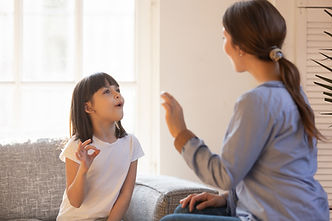 speech therapy between a therapist and a young girl in El Paso