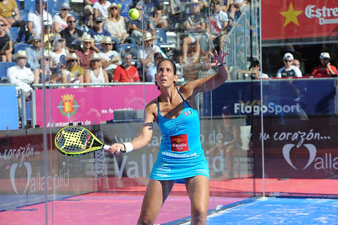 Woman playing padel on court