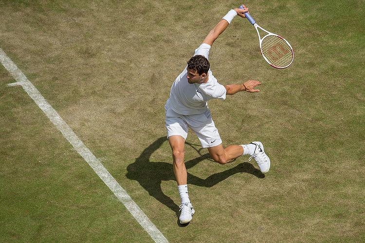 professional tennis player on grass court