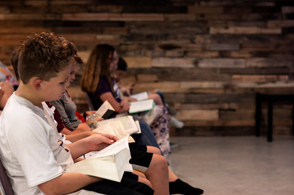 students reading the Bible