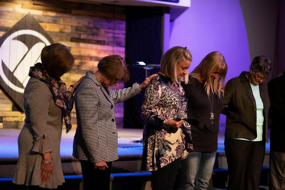 five women praying