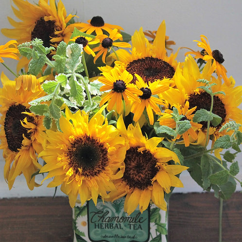 Sunflowers in an adorable vessel!