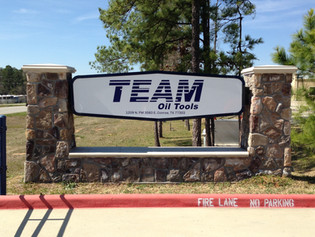 Team Oil Sign