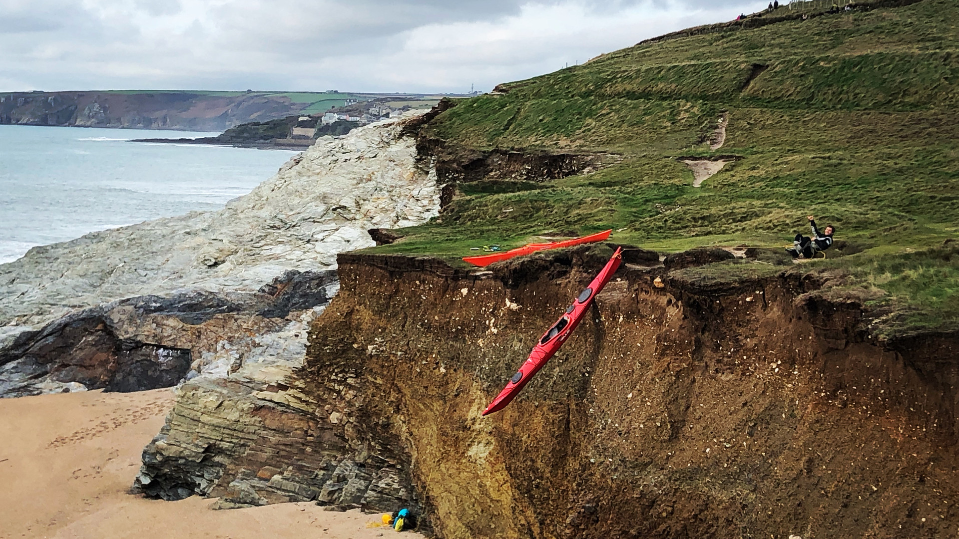 Lowering kayaks onto the beach