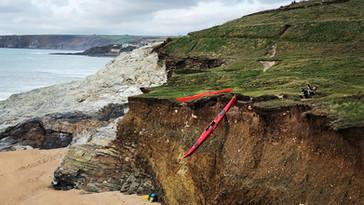 Lowering kayaks onto the beach