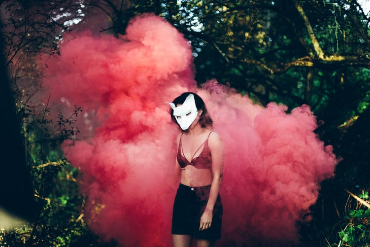 Woman In Black Shorts, Maroon Bralette, And White Fox Mask Stands In Front Of A Large Cloud Of Red Smoke In A Green Wood The Covert Narcissist Screwtape Letters Relationship Break-Up Self Improvement Lifestyle Advice Blog Fabsolutely Co