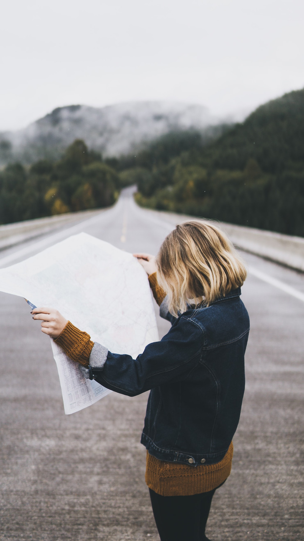 Blonde Person Standing In Middle Of Asphalt Road Through Conifer Forest With Gray Snowy Mountain In Distance Looks At Large Map Boundaries? What Do You Mean, Having Boundaries? Relationship Break-Up Self Improvement Lifestyle Advice Blog Fabsolutely Co