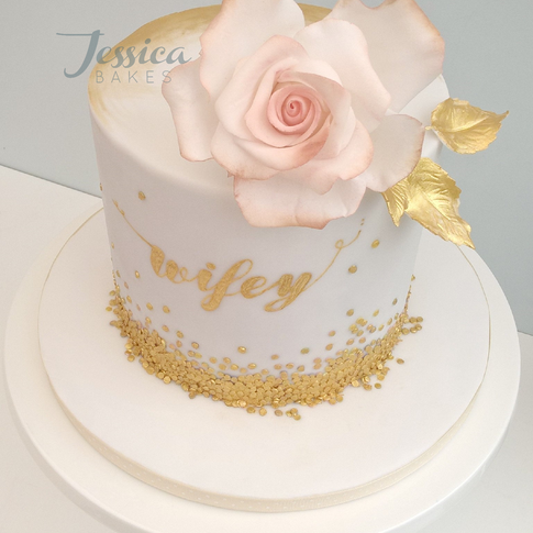 Rose and sequin celebration cake £150