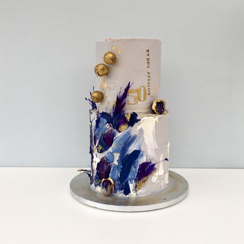 Blue Kinetic cake in buttercream