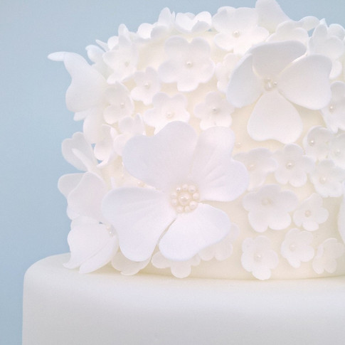 White Ruffle Blossom Wedding Cake
