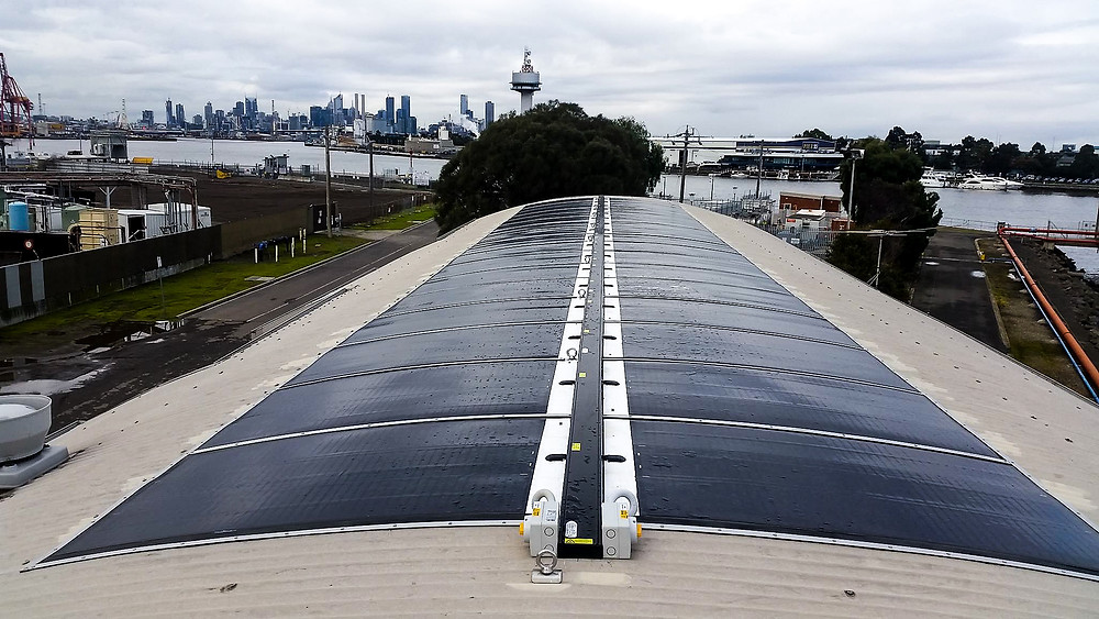 New technology solar panels on curved roof.