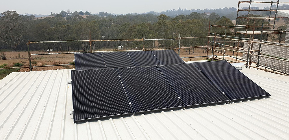 Mono solar panels on a low slope roof.