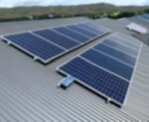 solar panels on tin roof