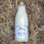 Organic whole milk in a glass bottle