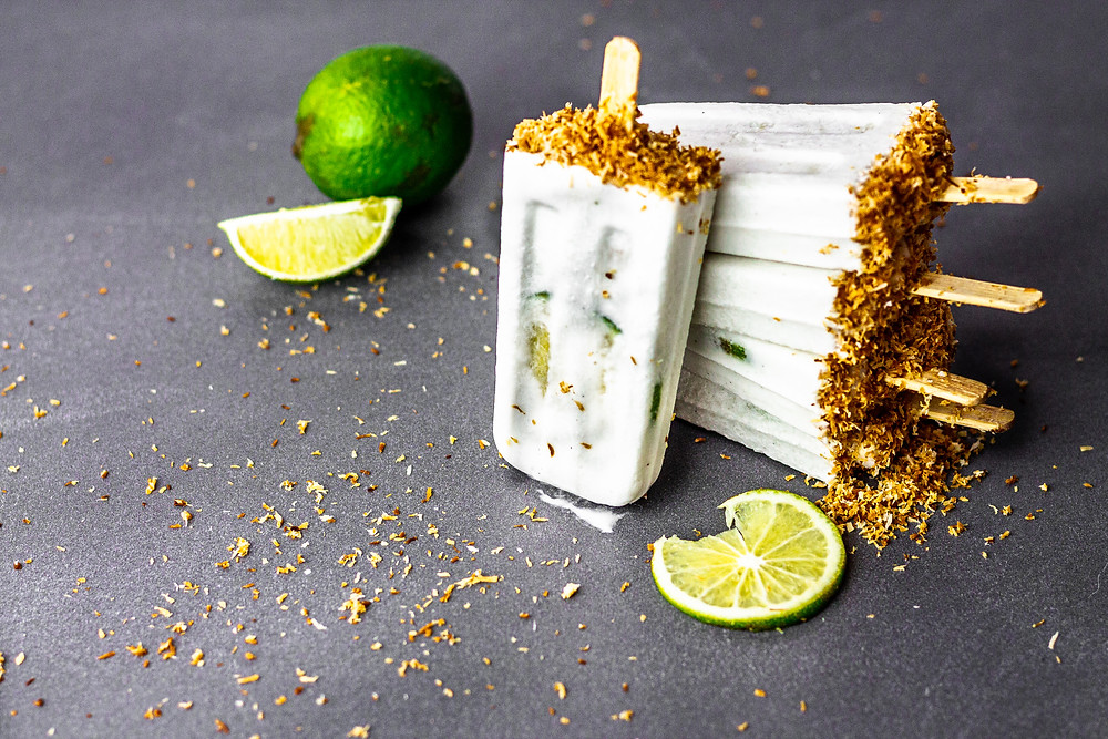 Pretty Delicious Life Dairy Free Toasted Coconut Lime Popsicles - It has recently been brought to my attention that I have been talking a littttttttle (uncharacteristically) bit too much about fall lately, so when I was asked to co-host a World Coconut Day recipe collab, I knew I needed to make something summery!