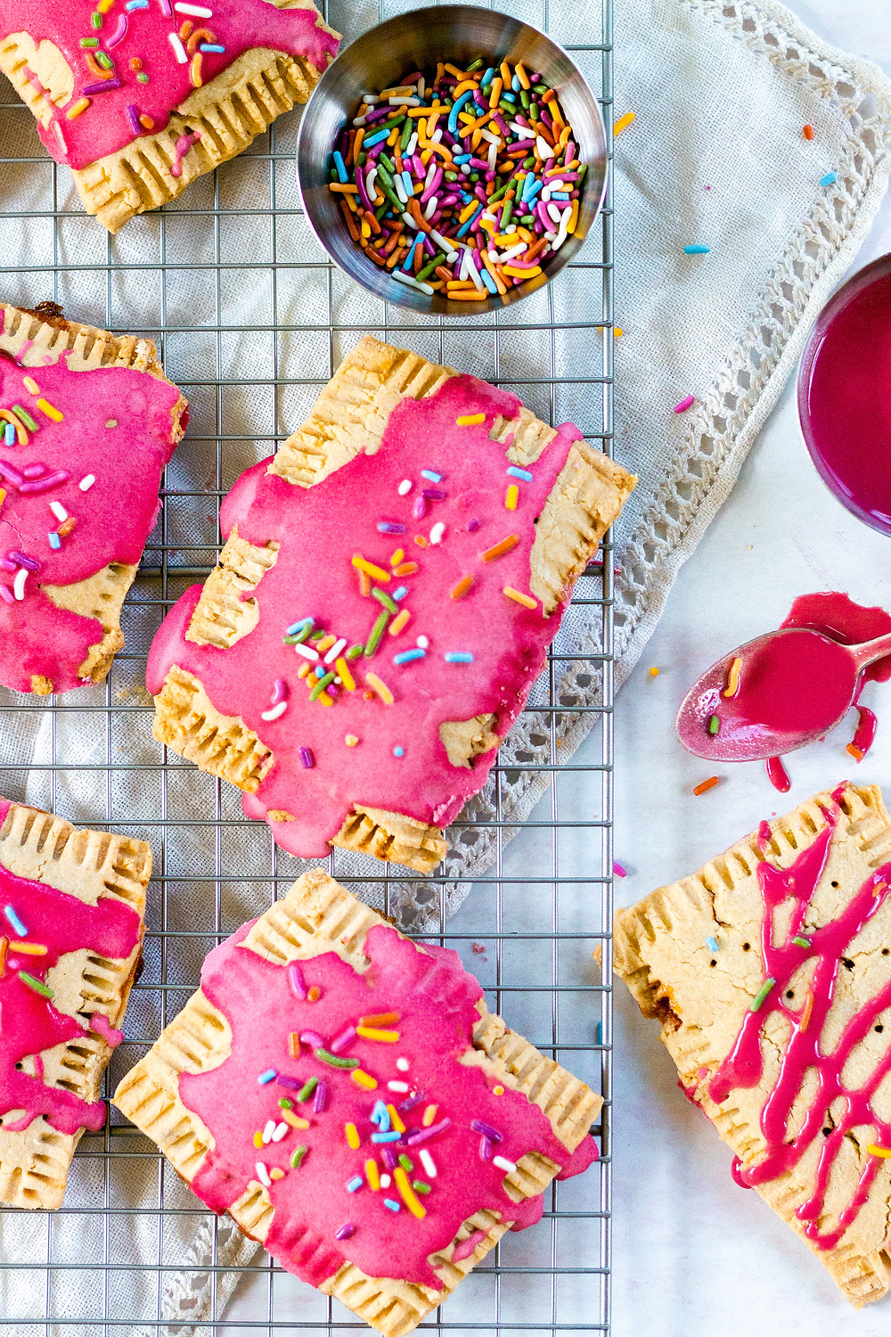 Pretty Delicious Life Berry Lemonade Paleo Pop Tarts - I challenge you to name one person that doesn't love pop tarts. Go ahead, I'll wait. See, you can't do it! Everyone loves these buttery, sweet treats but not everyone loves the laundry list of ingredients and in my case,