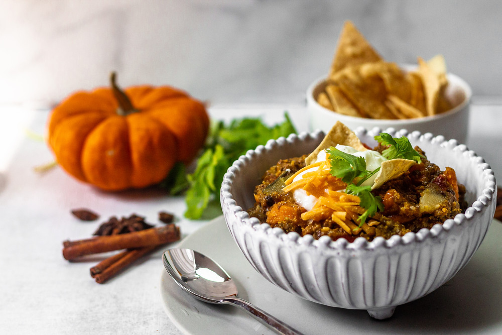 Pretty Delicious Life Low FODMAP Paleo Friendly Slow Cooker Pumpkin Chili - Fall is, without a doubt, the season where I start to get a little hands-off with my cooking. Sundays are my meal prep days, but football is BACK and I don't miss a game! Sometimes I will put it on in the living room so I can at least peek
