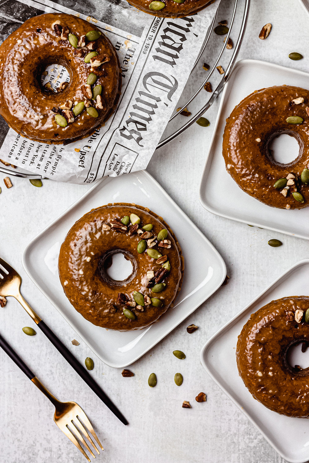 "Easy, Healthy, Paleo Pumpkin Pancake Donuts - Pretty Delicious Life - Did I just say ""healthy"" and ""donuts"" in the same sentence?! You bet I did! I've had a box of my favorite grain free pumpkin pancake mix hanging around for a little while and wanted to do something a little more creative than simply making"