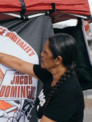 Mom Cindy Holding Jacob Flag