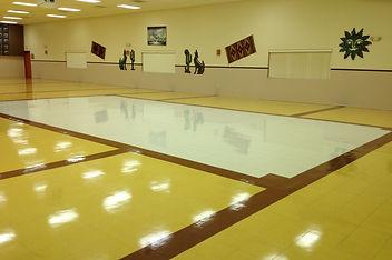 commercial waxed floor in school gymnasium