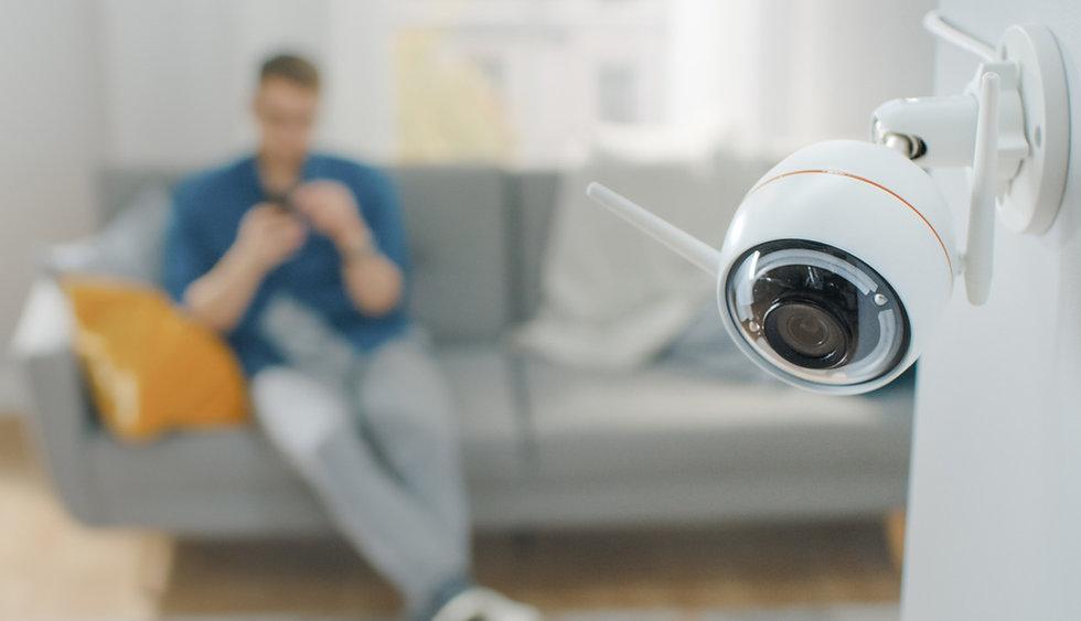 1140-home-security-man-camera.jpg