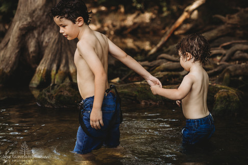 Mother and son portrait session in creek at Cibolo Nature Center in Boerne, Texas by Oh, Tannenbaum Photography