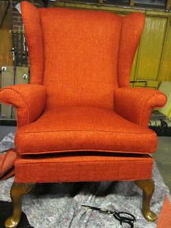 High-backed wing arm chair