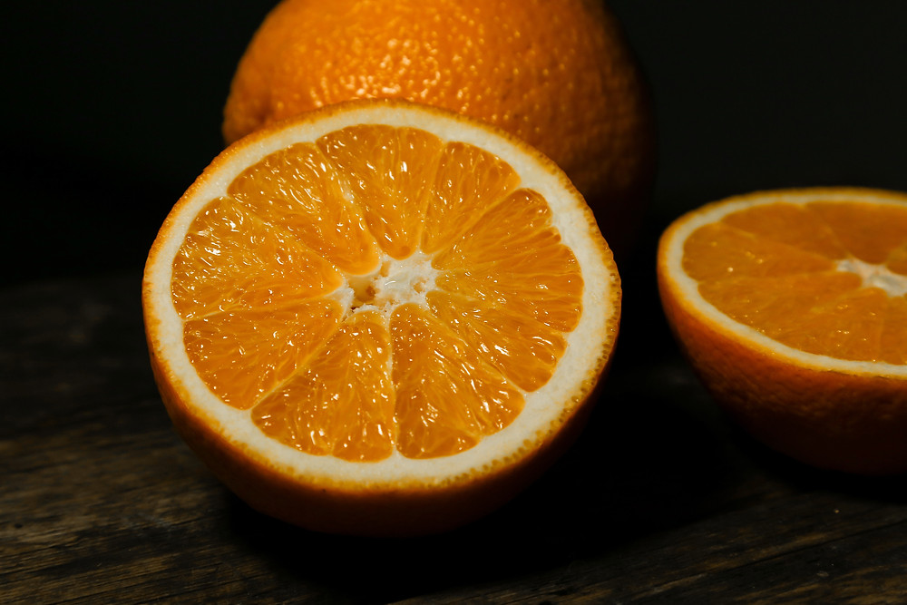 Picture of half an orange and segments