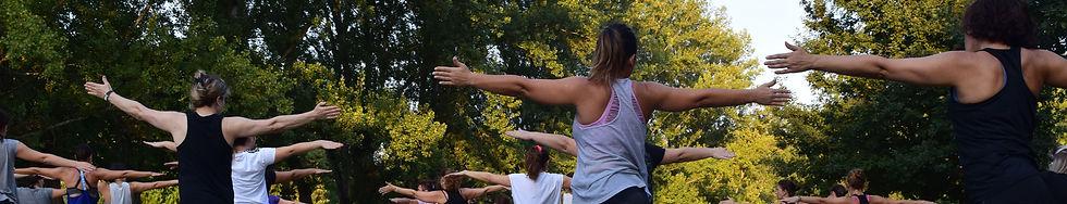 women-performing-yoga-on-green-grass-nea