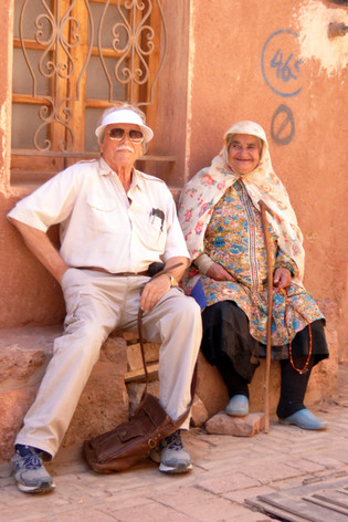 Tourist and old lady, Abyaneh Village, Iran