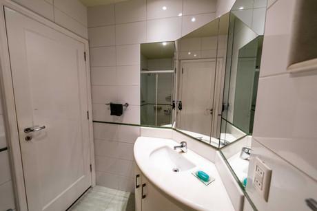Master suite bathroom sink and door