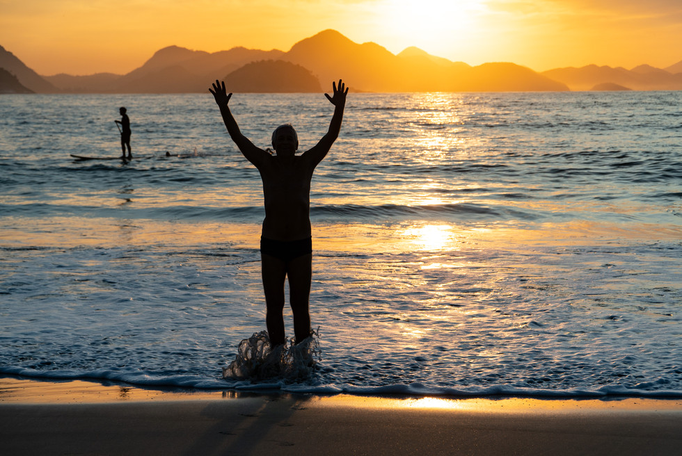 Swimmer greets the sun on Copacabana Beach