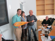 Donating the paddle used in the 1960 race to the sea