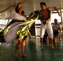 Carimbó dancers on a boat