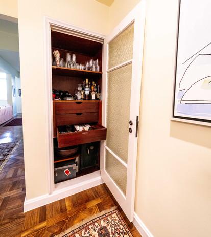 Dining room storage closet with safe
